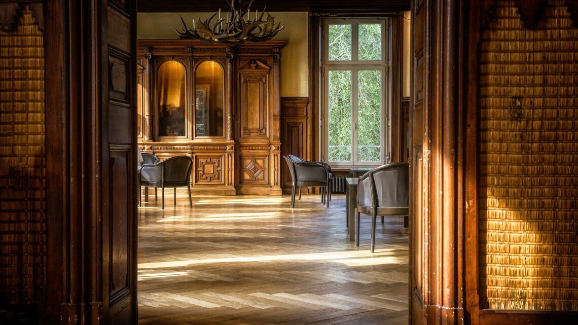 Our Best Decision Yet: Refinishing 100-Year-Old Wood Floors